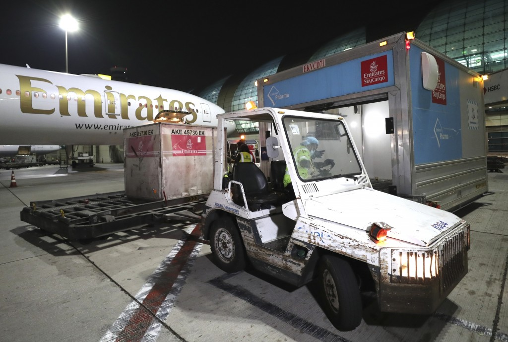 A Pfizer-BioNTech COVID-19 coronavirus vaccines shipment is offloaded from an Emirates Airlines Boing 777 that arrived from Brussels at Dubai Internat...