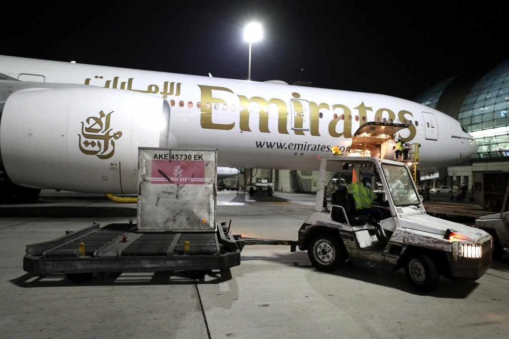 A Pfizer-BioNTech COVID-19 coronavirus vaccine shipment is offloaded from an Emirates Airlines Boing 777 that arrived from Brussels to Dubai Internati...