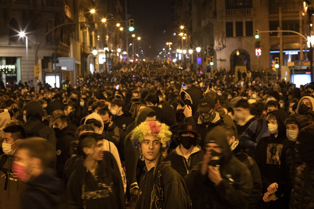 Demonstrators march during a protest condemning the arrest of rap artist Pablo Hasél in Barcelona, Spain, Friday, Feb. 19, 2021. The imprisonment of a...