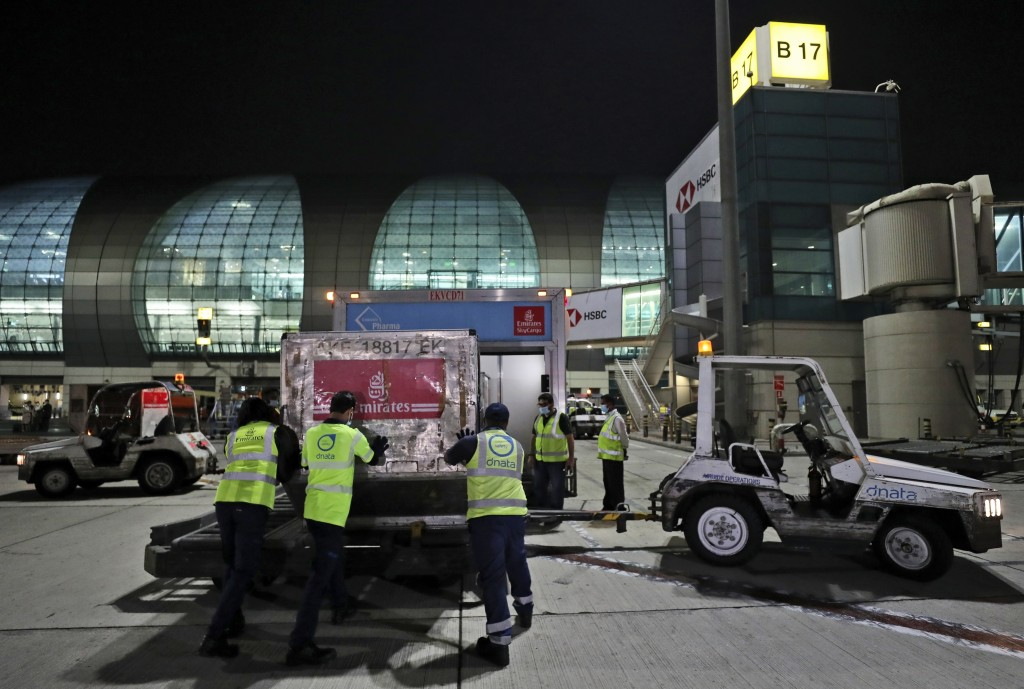 A shipment of Pfizer-BioNTech COVID-19 coronavirus vaccines is offloaded from an Emirates Airlines Boing 777 that arrived from Brussels to Dubai Inter...