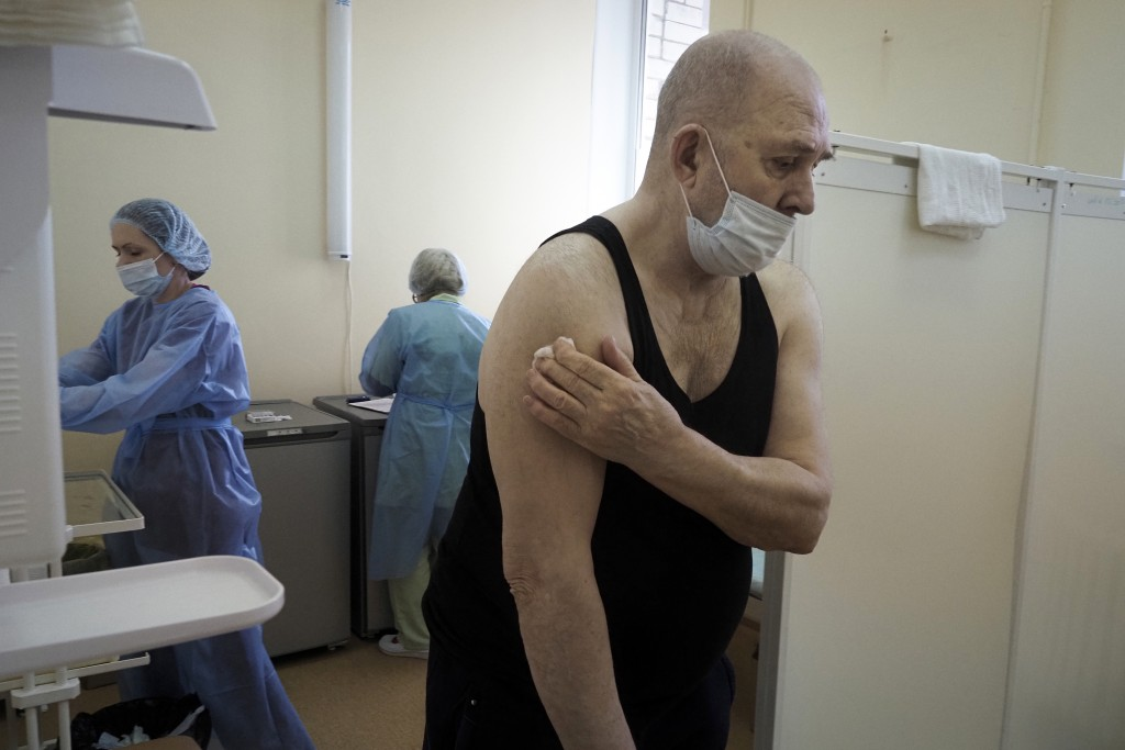 An elderly man leaves a room after getting a shot of Russia's Sputnik V coronavirus vaccine in the clinic in Petrozavodsk, Karelia region, Russia, Mon...