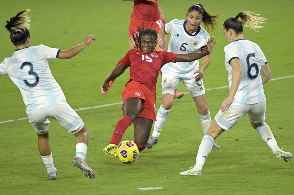 Canada forward Nichelle Prince (15) competes for a ball between Argentina defender Eliana Stabile (3), midfielder Vanesa Santana (5), and defender Ald...