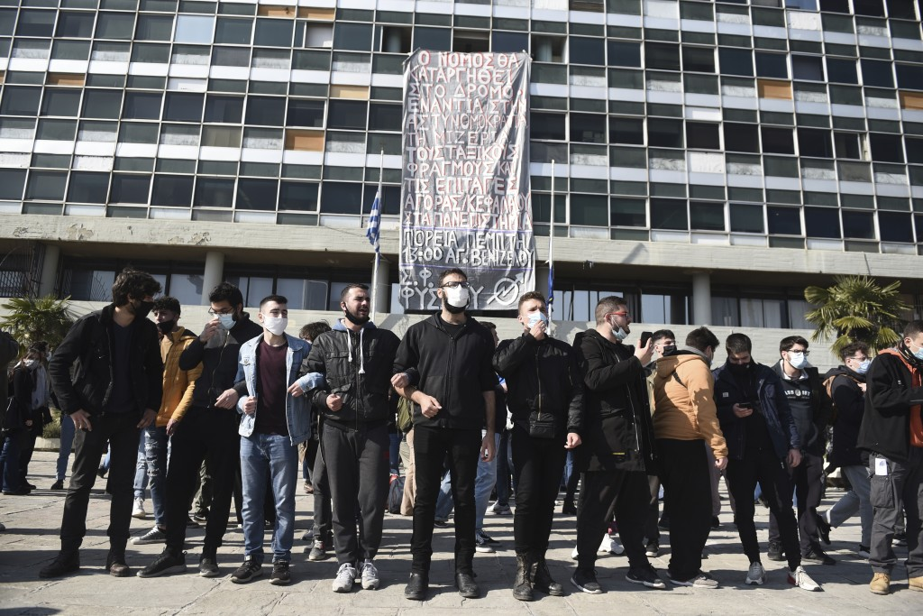Protesters chant slogans at the University of Thessaloniki in northern Greece, on Monday, Feb. 22, 2021. Police clashed with protesters and detained m...