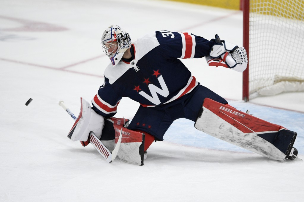 Washington Capitals goaltender Craig Anderson (31) leans towards the puck during the first period of an NHL hockey game against the New Jersey Devils,...