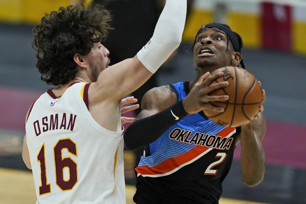 Oklahoma City Thunder's Shai Gilgeous-Alexander (2) drives to the basket against Cleveland Cavaliers' Cedi Osman (16) in the second half of an NBA bas...