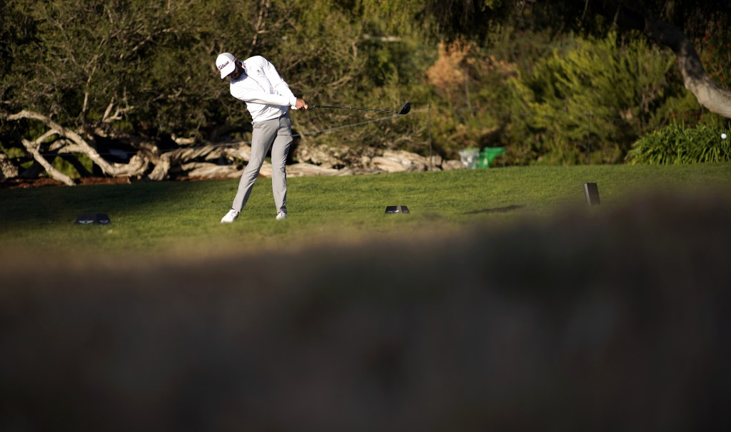Max Homa tees off on the 18th hole as third round play continues during the Genesis Invitational golf tournament at Riviera Country Club, Sunday, Feb....