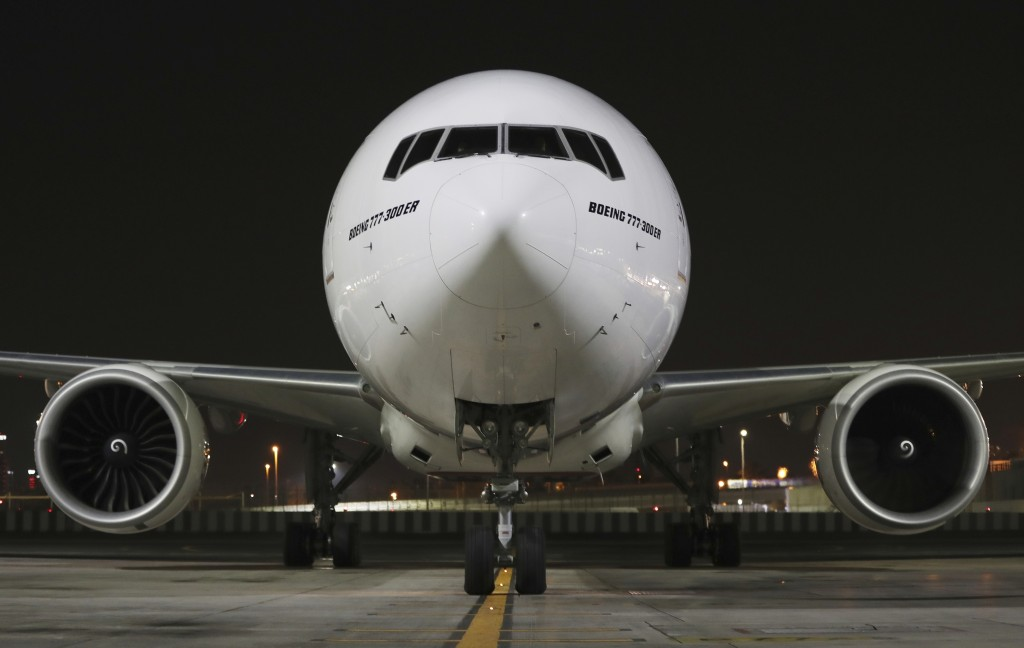 CORRECTS DATE TO EARLY SUNDAY FEB. 21, 2021 - An Emirates Airlines Boing 777 arrives from Brussels to deliver Pfizer-BioNTech COVID-19 coronavirus vac...