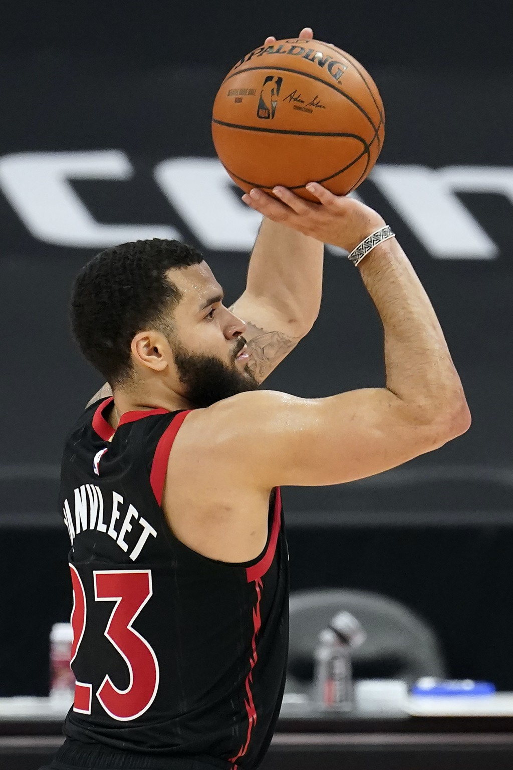 Toronto Raptors guard Fred VanVleet (23) puts up a shot against the Philadelphia 76ers during the second half of an NBA basketball game Sunday, Feb. 2...