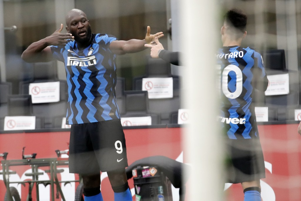 Inter Milan's Romelu Lukaku, left, celebrates with his teammate Lautaro Martinez after scoring his side's third goal during the Serie A soccer match b...
