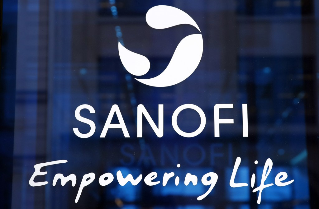 FILE - In this Feb. 7, 2019 the logo of French drug maker Sanofi is pictured at the company's headquarters, in Paris. Sanofi is going to produce as ma...