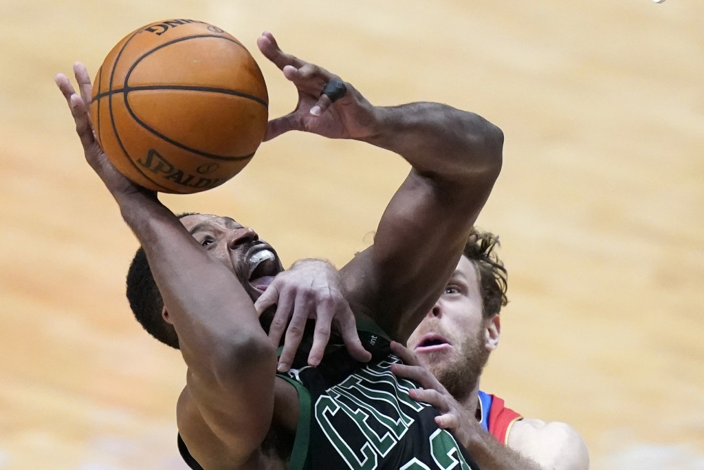 Boston Celtics forward Tristan Thompson, left, is fouled by New Orleans Pelicans forward Nicolo Melli as he drives to the basket in the second half of...