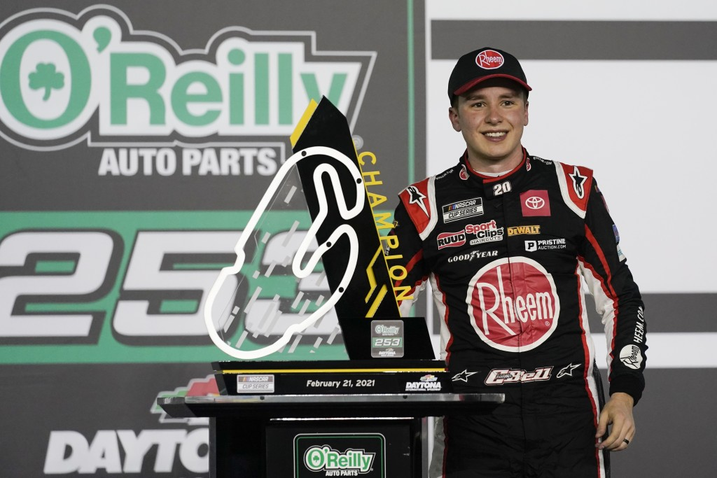 Christopher Bell celebrates in Victory Lane after winning the NASCAR Cup Series road course auto race at Daytona International Speedway, Sunday, Feb. ...