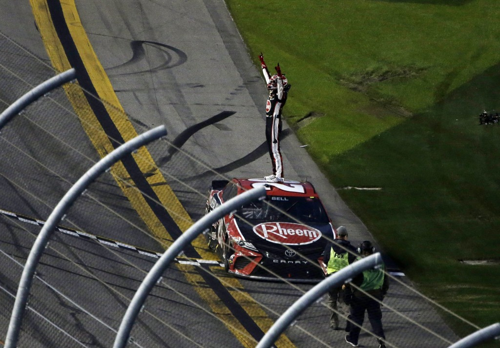 Christopher Bell celebrates at the finish line after winning the NASCAR Cup Series road course auto race at Daytona International Speedway, Sunday, Fe...