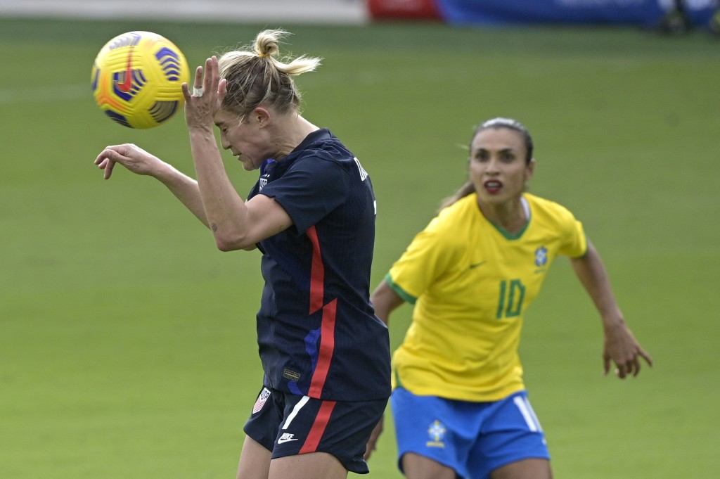 United States defender Abby Dahlkemper (7) heads a ball in front of Brazil midfielder Marta (10) during the first half of a SheBelieves Cup women's so...