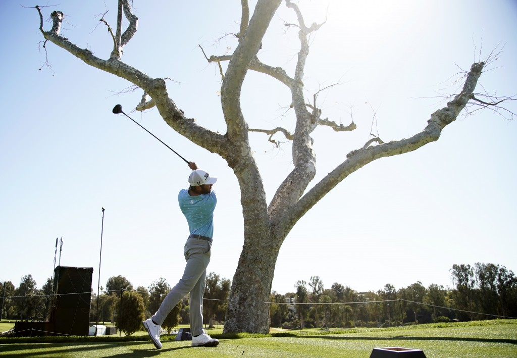 Max Homa tees off on the third hole during the final round of the Genesis Invitational golf tournament at Riviera Country Club, Sunday, Feb. 21, 2021,...