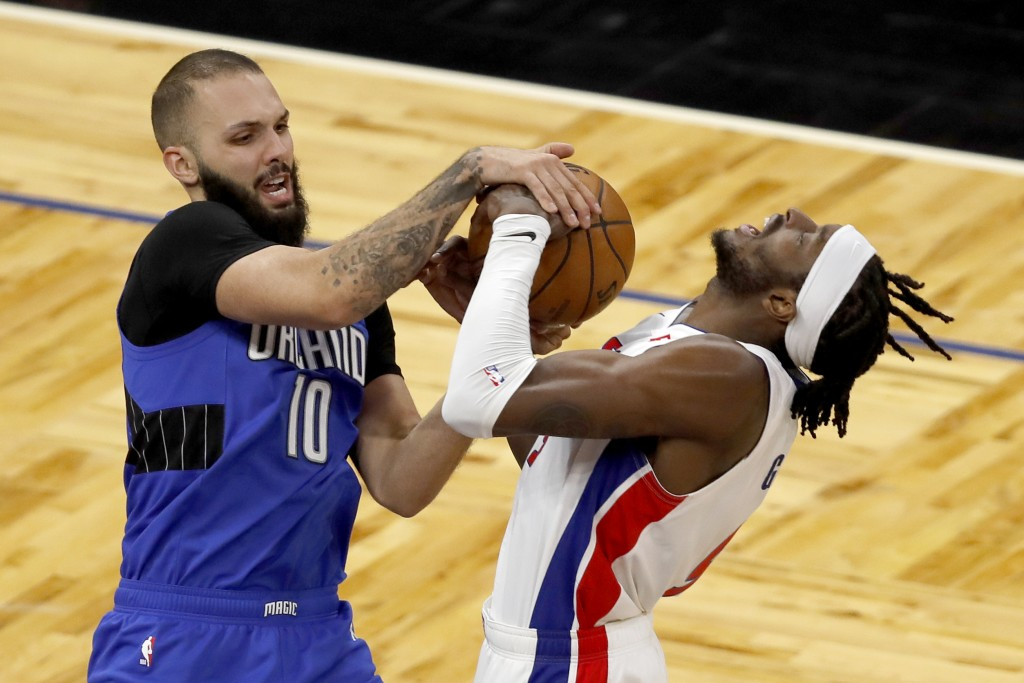 Orlando Magic guard Evan Fournier (10) battles Detroit Pistons forward Jerami Grant (9) for the ball in the first half during an NBA basketball game, ...