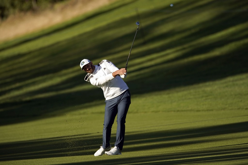 Dustin Johnson hits his second shot on the 18th hole as third round play continues during the Genesis Invitational golf tournament at Riviera Country ...