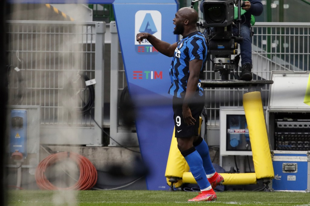 Inter Milan's Romelu Lukaku celebrates after scoring his side's third goal during the Serie A soccer match between AC Milan and Inter Milan, at the Mi...