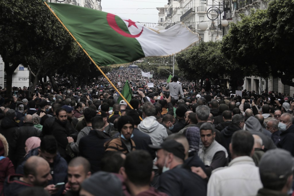 Algerians demonstrate in Algiers to mark the second anniversary of the Hirak movement, Monday Feb. 22, 2021. Thousands of protesters marking the secon...