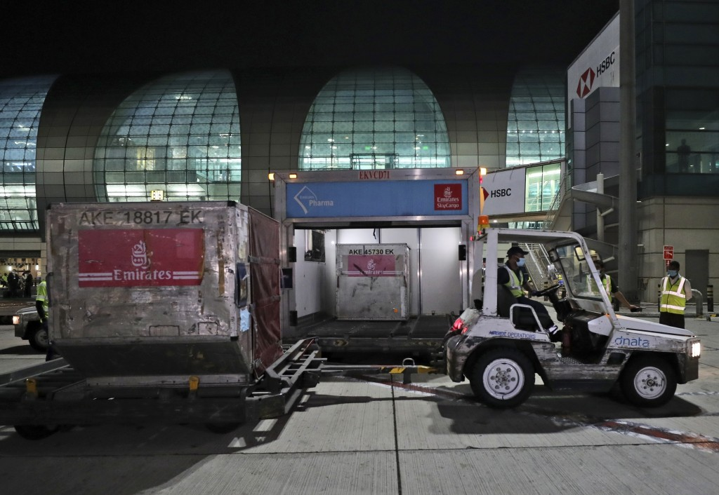 A shipment of Pfizer-BioNTech coronavirus vaccines is offloaded from an Emirates Airlines Boing 777 that arrived from Brussels to Dubai International ...