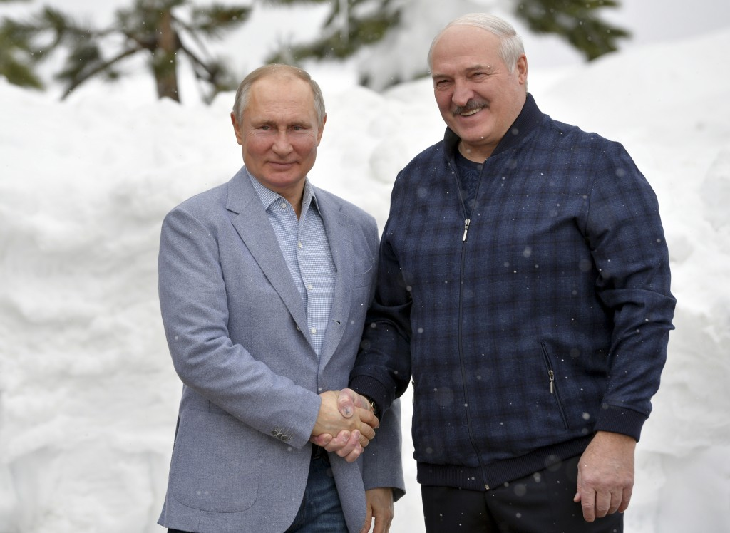 Russian President Vladimir Putin, left, and Belarusian President Alexander Lukashenko pose for a photo during their meeting in the Black Sea resort of...