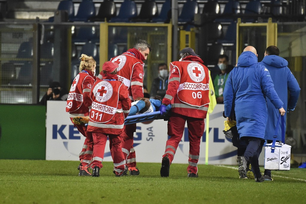 Napoli's Victor Osimhen is carried away on a stretcher during a Serie A soccer match between Atalanta and Napoli, in Bergamo's Atleti Azzurri d'Italia...