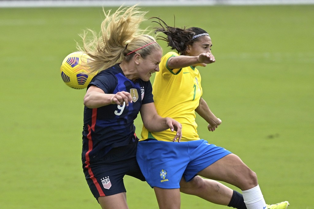 United States midfielder Lindsey Horan (9) and Brazil midfielder Andressa (7) compete for a header during the first half of a SheBelieves Cup women's ...