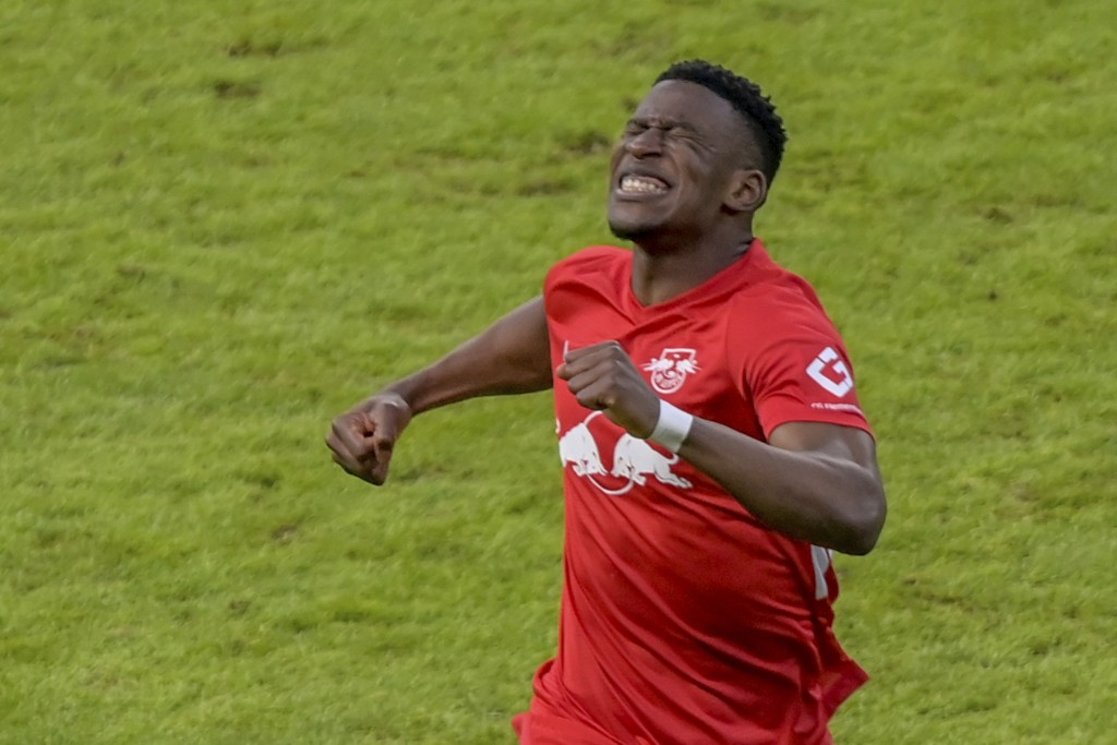 Leipzig's Nordi Mukiele celebrates after scoring his side second goal during the German Bundesliga soccer match between Hertha BSC Berlin and RB Leipz...