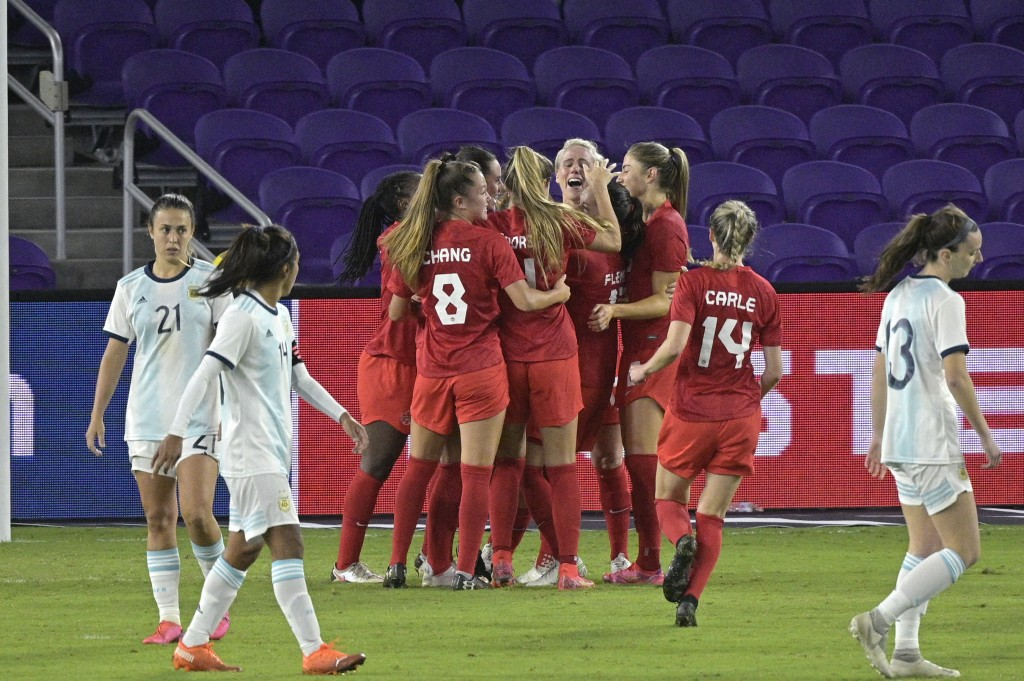 Canada players celebrate after midfielder Sarah Stratagakis scored a goal during the second half of a SheBelieves Cup women's soccer match against Arg...