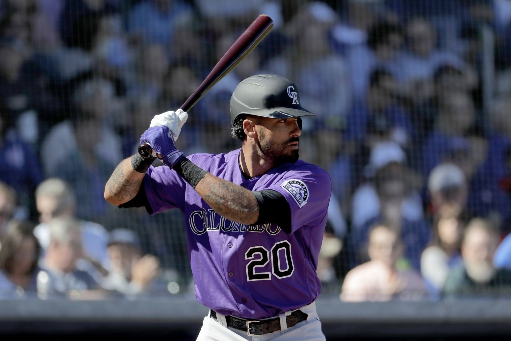 Colorado Rockies' Ian Desmond during the first inning of a spring training baseball game against the Chicago Cubs, Tuesday, Feb. 25, 2020, in Mesa, Ar...
