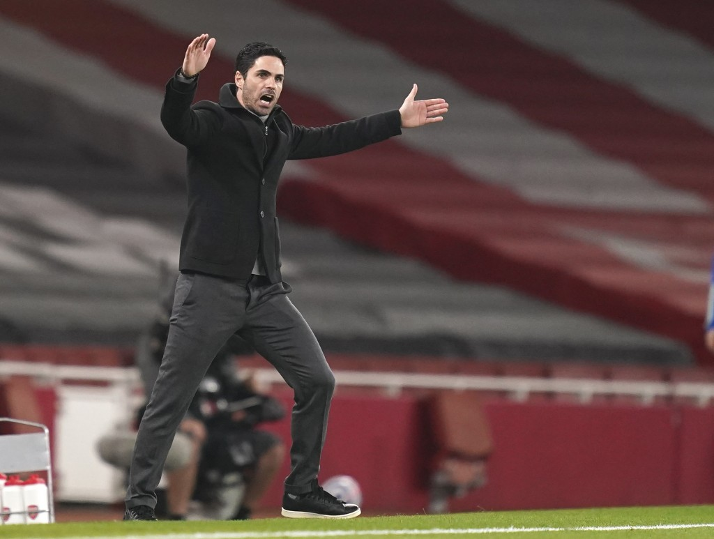 Arsenal's manager Mikel Arteta reacts during the English Premier League soccer match between Arsenal and Manchester City at the Emirates stadium in Lo...