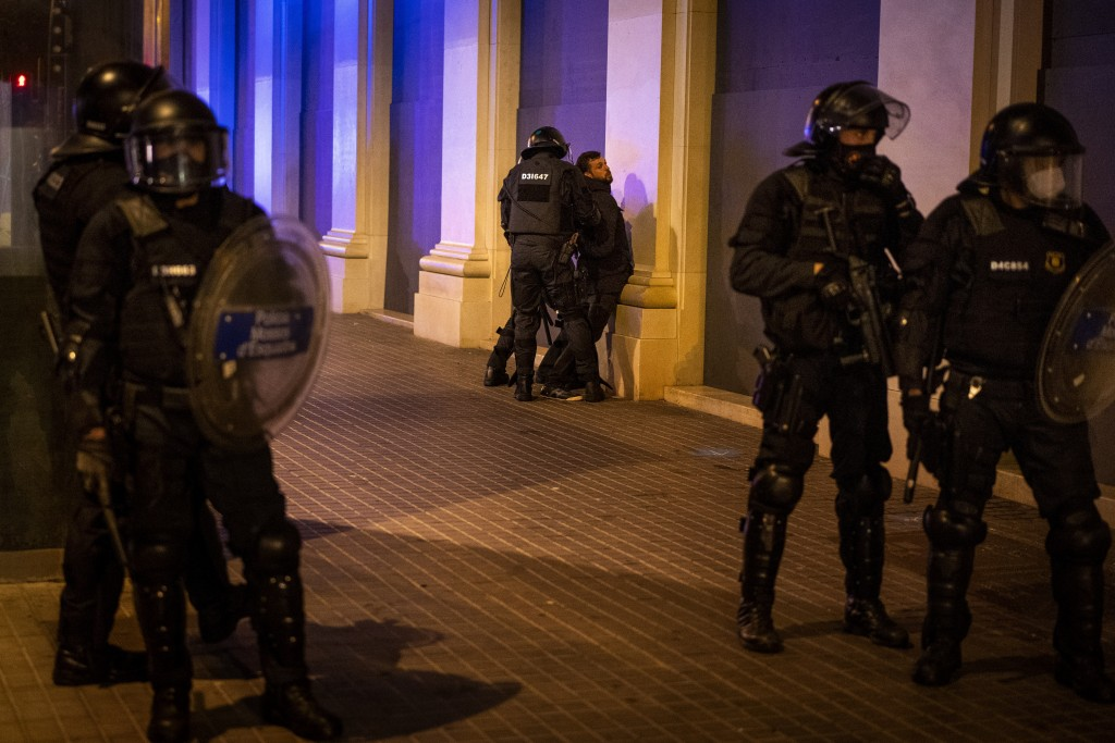 A man is detained by Catalan police officers during clashes following a protest condemning the arrest of rap artist Pablo Hasél in Barcelona, Spain, S...