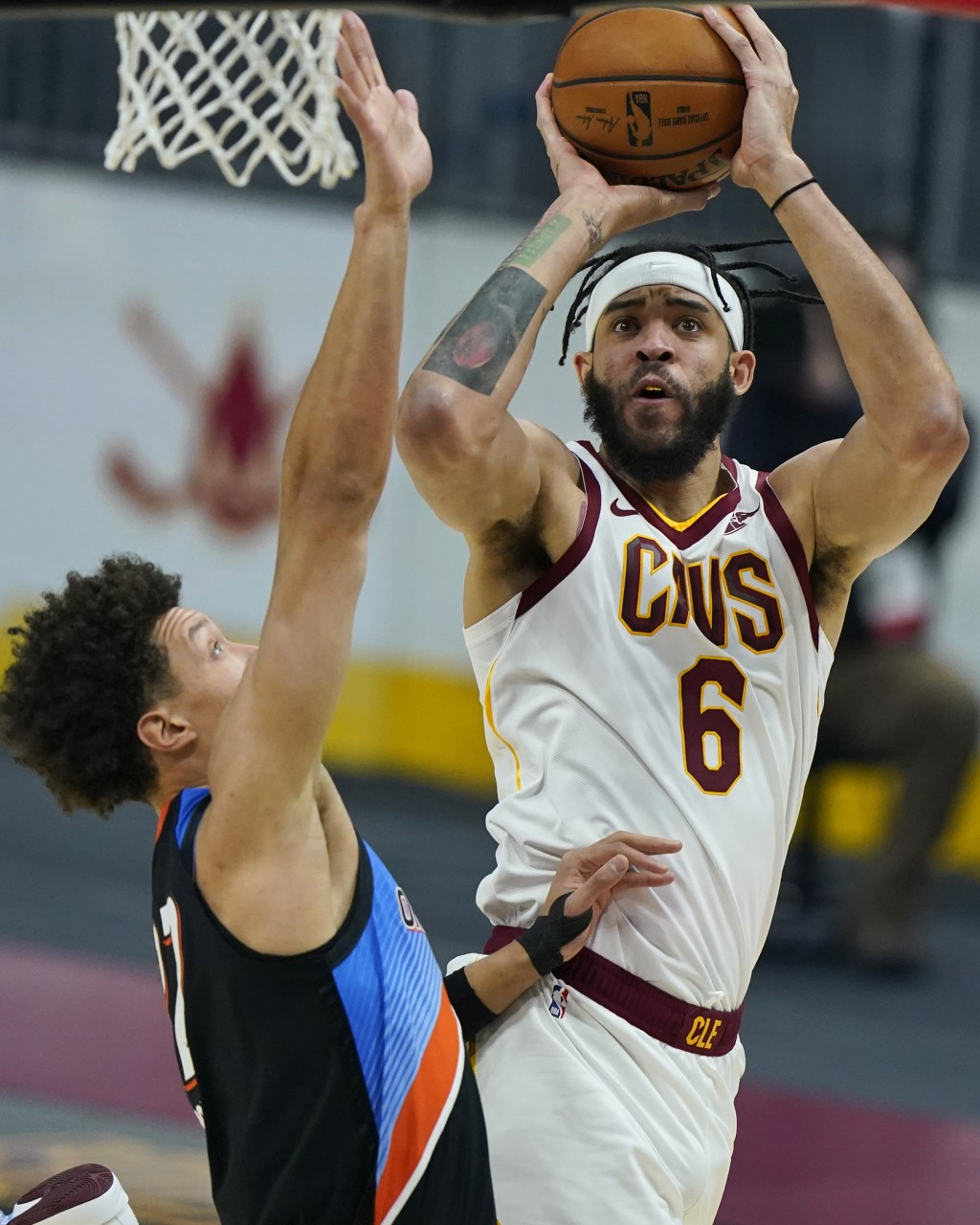 Cleveland Cavaliers' JaVale McGee, right, shoots over Oklahoma City Thunder's Isaiah Roby during the first half of an NBA basketball game Sunday, Feb....