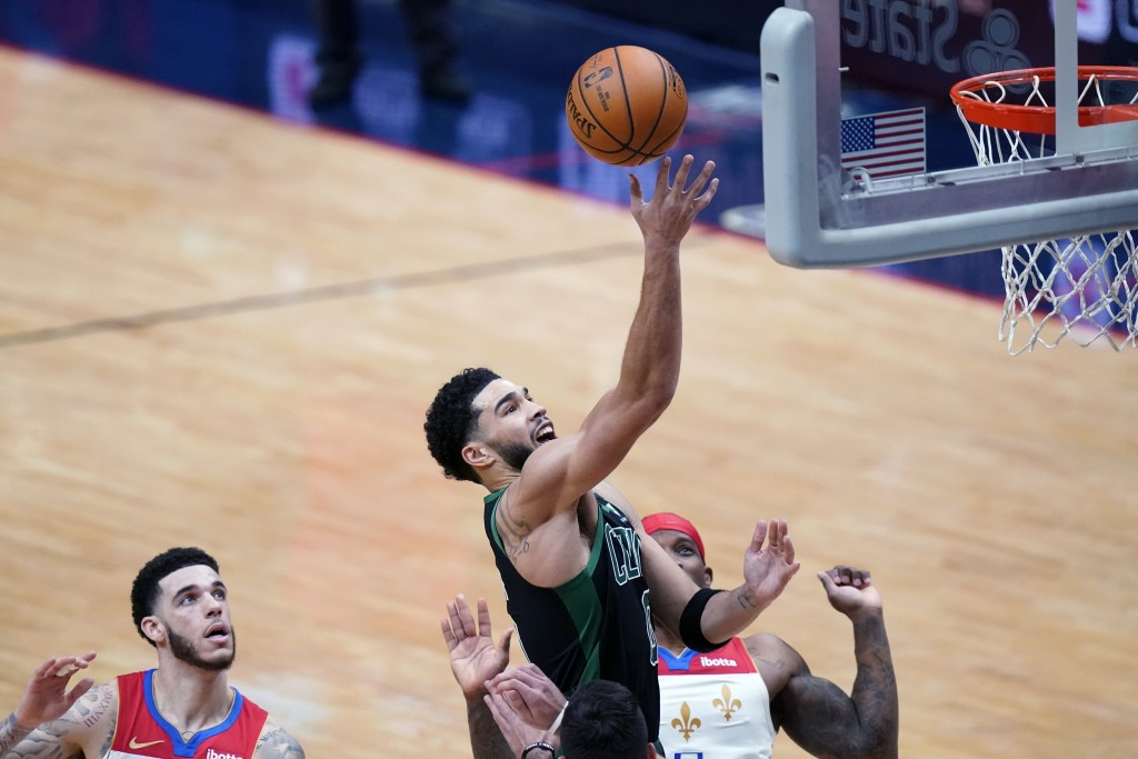 Boston Celtics forward Jayson Tatum (0) goes to the basket in the second half of an NBA basketball game against the New Orleans Pelicans in New Orlean...