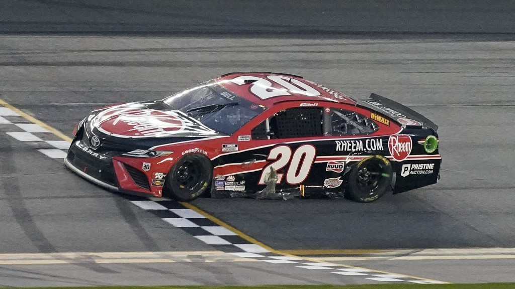 Christopher Bell crosses the finish line to win the NASCAR Cup Series road course auto race at Daytona International Speedway, Sunday, Feb. 21, 2021, ...