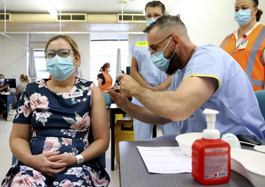 Nurse manager Sue McGrady receives the Pfizer vaccine at the Royal Prince Alfred Hospital Vaccination Hub in Sydney, Australia, Monday, Feb. 22, 2021....
