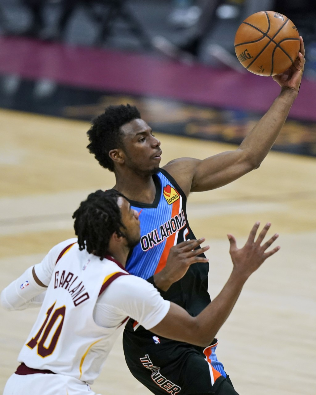 Oklahoma City Thunder's Hamidou Diallo, right, drives to the basket against Cleveland Cavaliers' Darius Garland during the second half of an NBA baske...