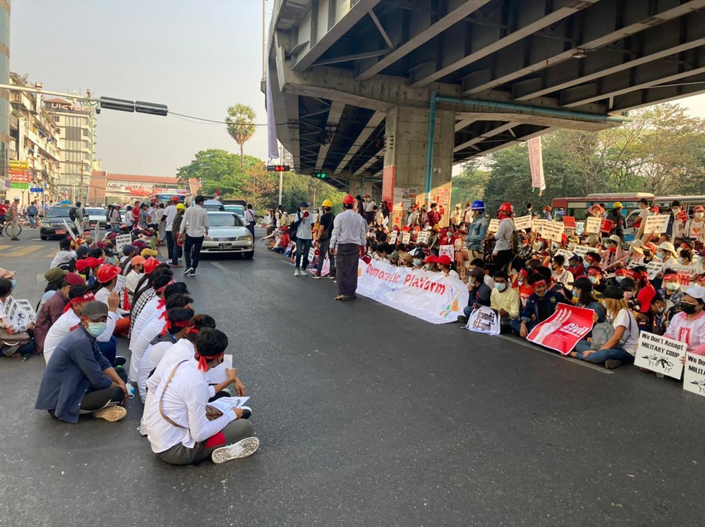 Anti-coup protesters gather under an elevated roadway just outside the Hledan Centre in Yangon, Myanmar Monday, Feb. 22, 2021. A call for a Monday gen...