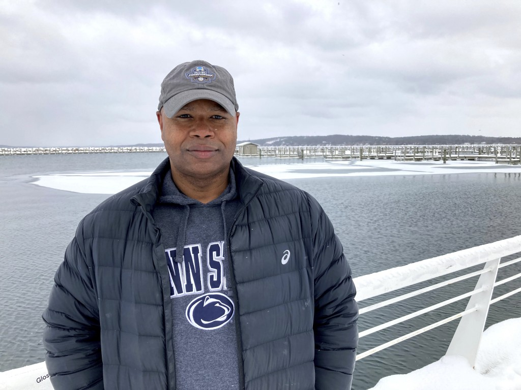 Chris Stone poses along the Grand Traverse Bay waterfront in Traverse City, Mich., Feb. 13, 2021. Stone is among local residents who have criticized a...
