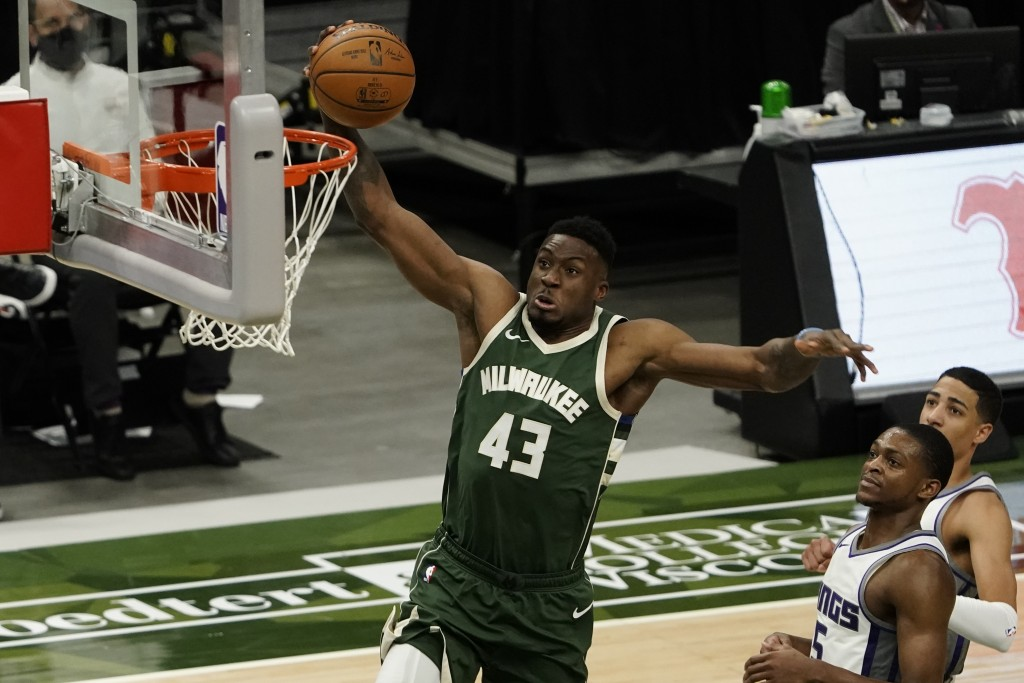 Milwaukee Bucks' Thanasis Antetokounmpo dunks during the second half of an NBA basketball game against the Sacramento Kings Sunday, Feb. 21, 2021, in ...