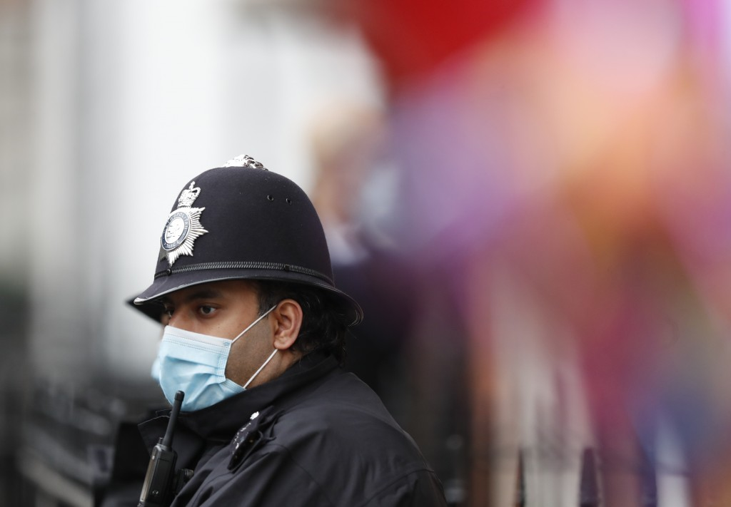 A police officer stands guard outside the King Edward VII hospital In London, Monday, Feb. 22, 2021, where Britain's Prince Philip is being treated. P...