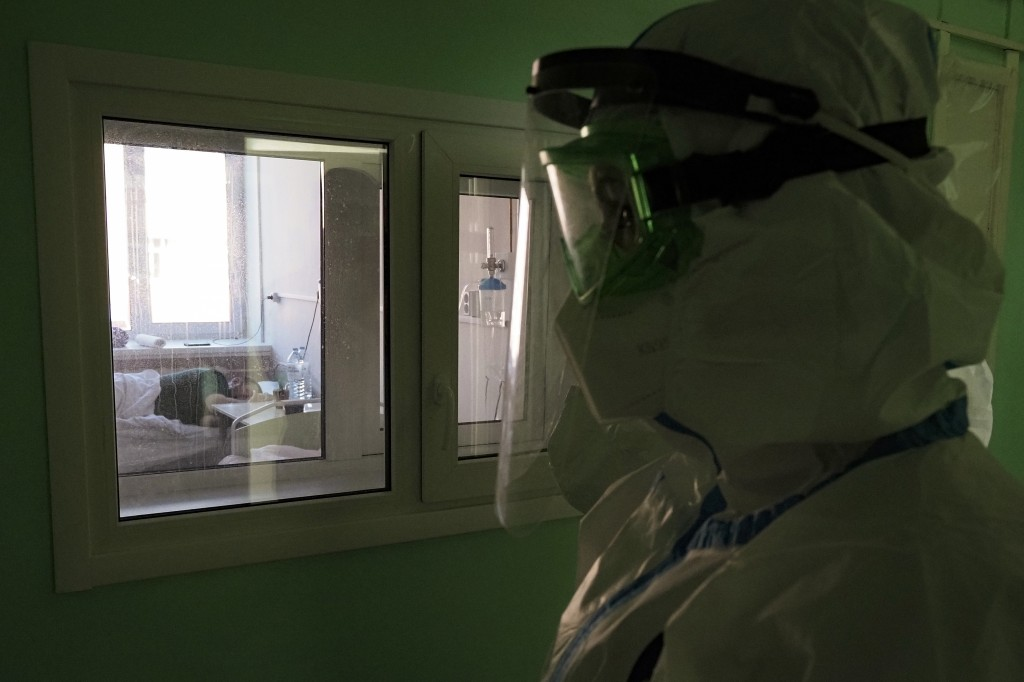 A medical worker walks into a coronavirus ward in a hospital in Sortavala, Karelia region, Russia, Tuesday, Feb. 16, 2021. Russia's rollout of its cor...