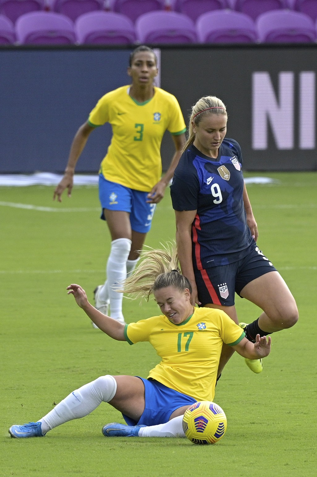 Brazil midfielder Andressinha (17) and United States midfielder Lindsey Horan (9) collide while competing for a ball during the first half of a SheBel...