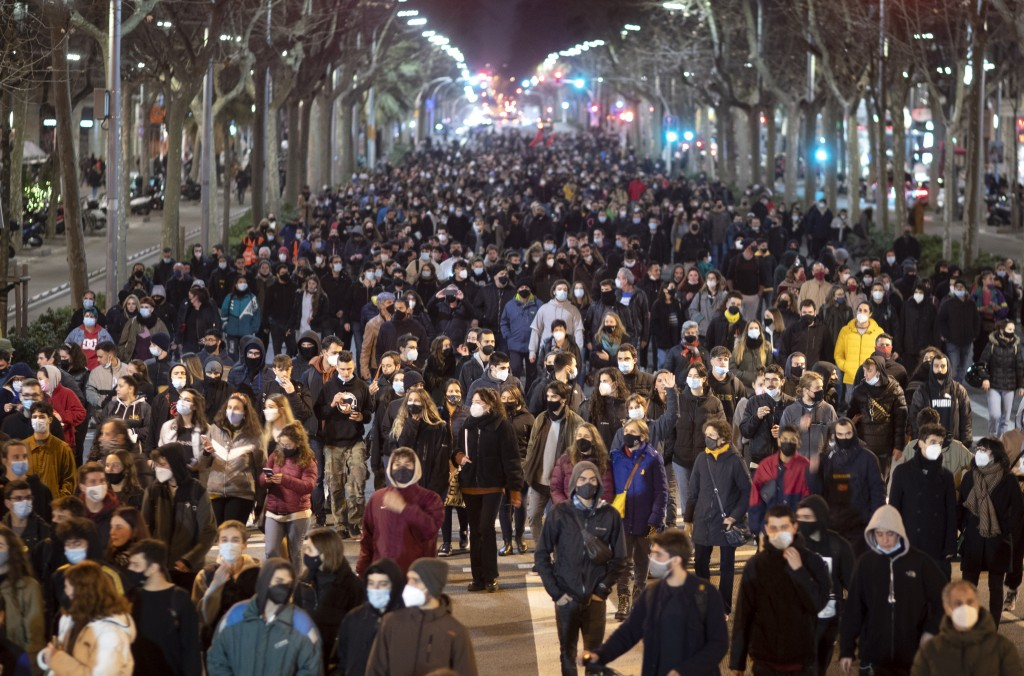 Supporters of rap artist Pablo Hasél demonstrate condemning his arrest in Barcelona, Spain, Tuesday, Feb. 16, 2021. The imprisonment of a rap artist f...