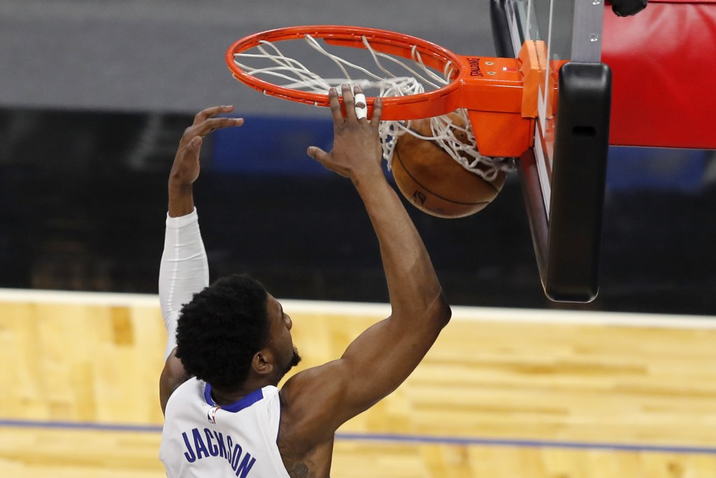 Detroit Pistons guard Josh Jackson (20) scores in the first quarter against the Orlando Magic during an NBA basketball game, Sunday, Feb. 21, 2021, in...