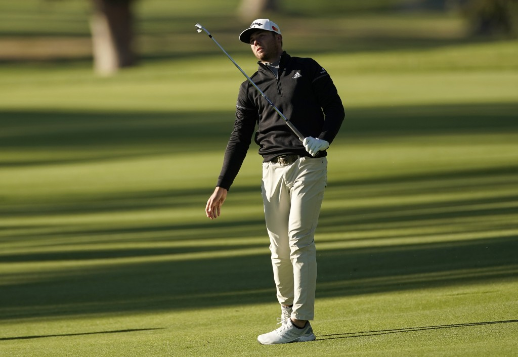 Sam Burns reacts after hitting his second shot on the 18th hole as third round play continues during the Genesis Invitational golf tournament at Rivie...