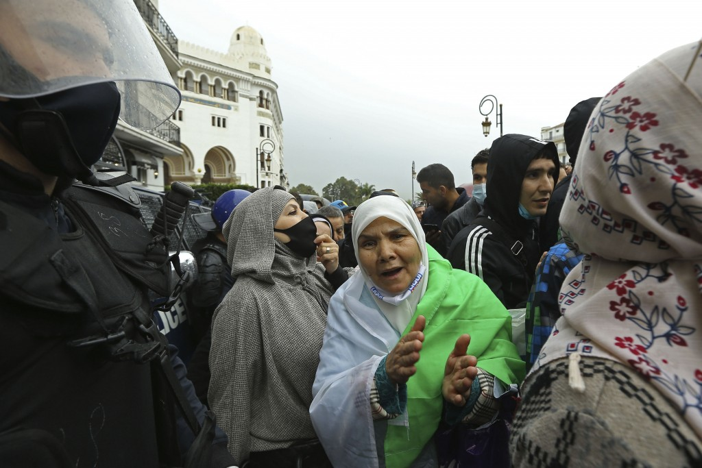Women take part to demonstration in Algiers to mark the second anniversary of the Hirak movement, Monday Feb. 22, 2021. February 22 marks the second a...