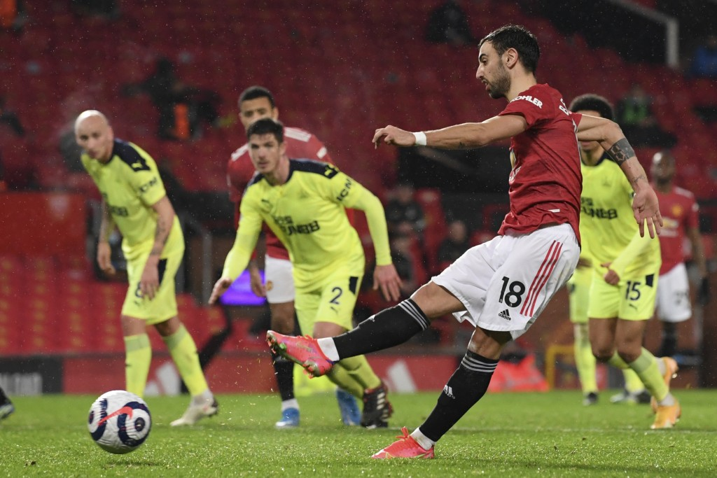 Manchester United's Bruno Fernandes scores his side's third goal from the penalty spot during an English Premier League soccer match between Mancheste...