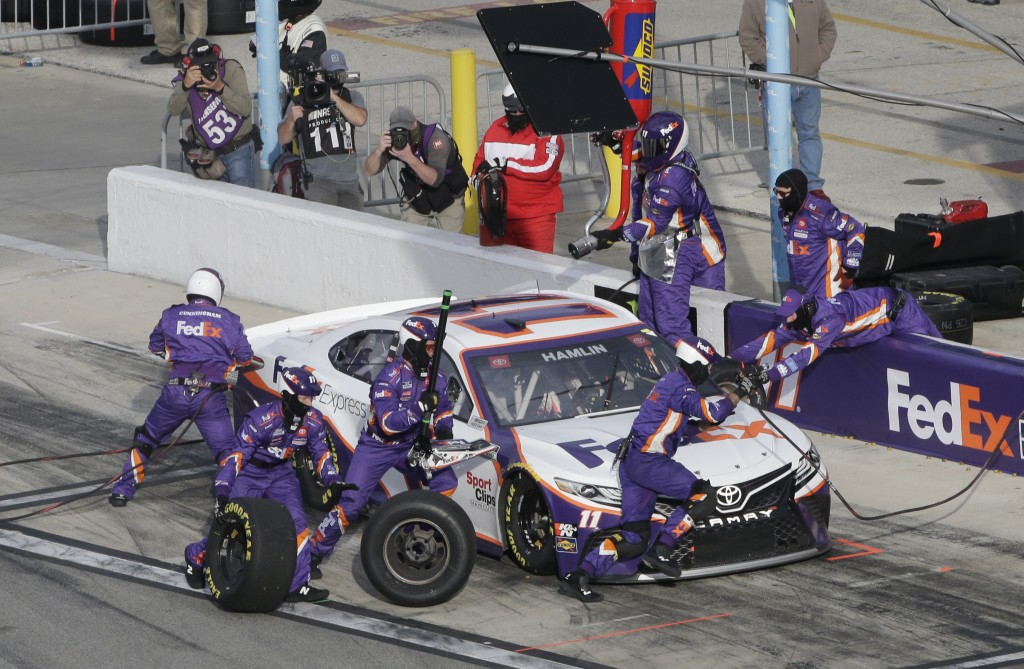 Denny Hamlin makes a pit stop during the NASCAR Cup Series road course auto race at Daytona International Speedway, Sunday, Feb. 21, 2021, in Daytona ...