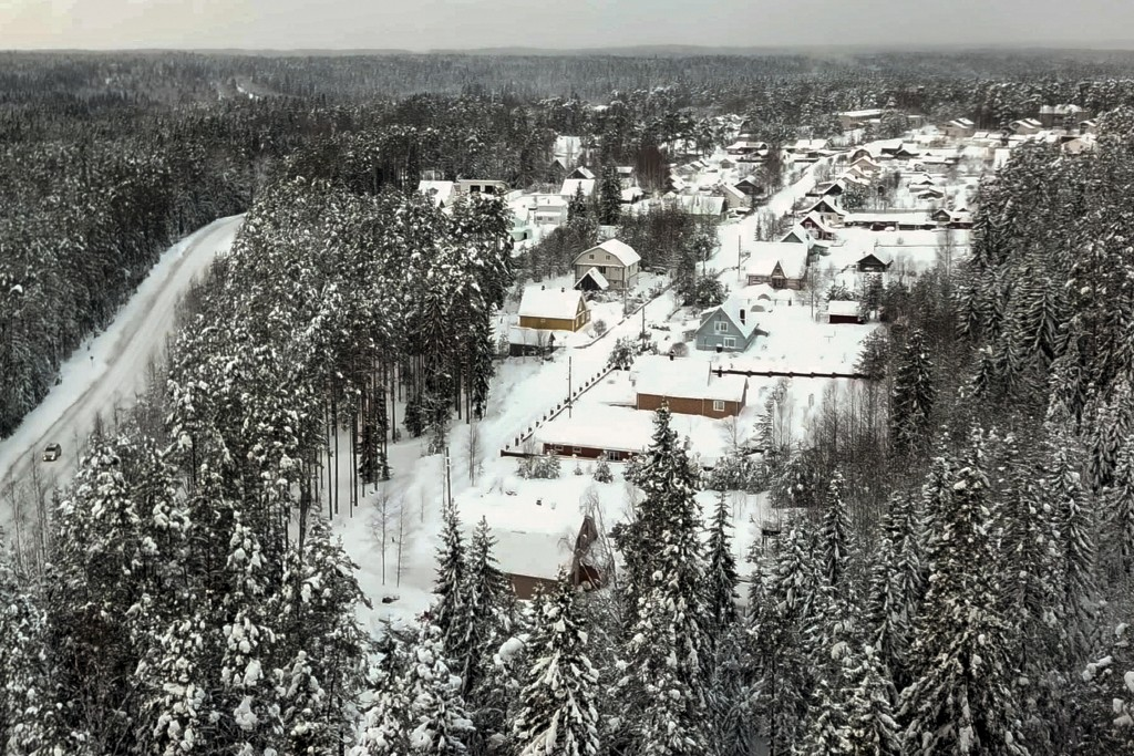 Snow coats the village of Ikhala in Russia's Karelia region, Tuesday, Feb. 16, 2021. Russia's rollout of its coronavirus vaccine is only now picking u...